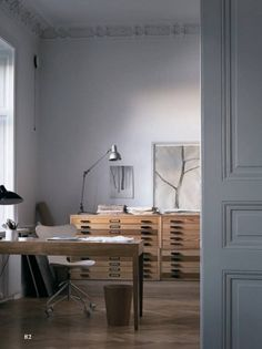 An Artist's Stockholm Apartment: Working at Home. Want the storage.