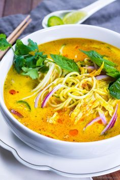 Chicken Khao Soi - A deliciously sweet and spicy Yellow Coconut Curry Soup made with homemade Thai yellow curry paste. Loaded with white meat chicken and rice (zucchini) noodles. This flavorful so. Curry Recipes, Asian Recipes, Soup Recipes, Vegetarian Recipes, Chicken Recipes, Cooking Recipes, Healthy Recipes, Thai Recipes, Healthy Foods