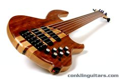 Custom Bass Guitars | Custom Shop Bubinga top, fretless Sidewinder 6 string bass