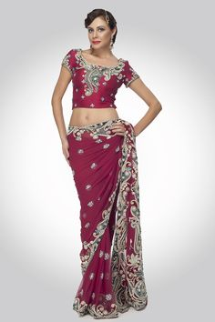 Maroon New Embellished: A paisley ornamental border saree created on delicate net  with doriwork, pearls, stonework and all over sprinkled jewel buttis. comes with a cap sleeve silk blouse with ornamental paisley zardozi embroidery on neck and sleeves. A perfect bridal wear.