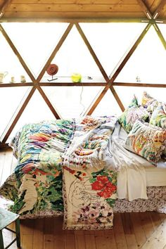 Colourful patterned bedspread.