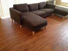 ceramic wood tile that pretty much matches the color of the living room/kitchen flooring. Wide plank look.