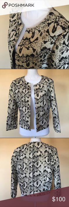 "Pim+Larkin Snake Print Metallic Cropped Jacket L NWT cropped black snake print w/cream tone & gold metallic thread jacket size Large but its European therefore runs smaller. Fabric has no stretch, material is snug. Style: slim fit. Shell 60% polyester, 34% cotton, 6% metallic, lining 51% polyester, 49% viscose. Top/bottom 22"" long, armpit/armpit 20.5"" wide. Offers are welcome! Pim+Larkin Jackets & Coats Blazers"