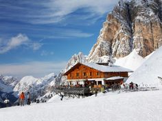 We recommend skiers visit Cortina d'Ampezzo. This popular winter sports resort town is known for its ski ranges, shops and après-ski scene. Nestled in an alpine valley surrounded by the Alps, Cortina was also a popular movie location for films including The Pink Panther, Cliffhanger and the James Bond flick For Your Eyes Only.
