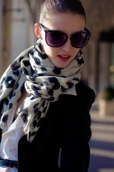 White collared shirt, leopard scarf, mustard belt, black blazer