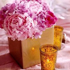 switch from grouping of mixed gold vases to 0ne large gold vases with florals and mixed candles?