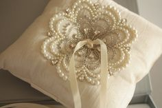 Fall Leaf is the epitome of glamor, exquisite bead work on luxurious silk fabric. The pillow measures approximately 6 inches on each side. Finished with grey satin ribbon in the center for the rings.