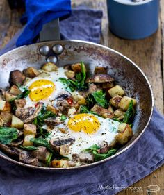 Quick breakfast skillet made on the stove loaded with spinach, mushrooms, potatoes and two sunny side up eggs. Healthy and filling recipe idea kids love