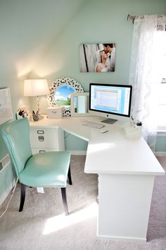 Very pretty office in bedroom using clean white desk and soft muted Tiffany blue/aqua on walls and leather chair