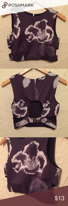 NWT ANGL Black Floral Crop Top Brand new with tags! Cuts outs on the side and back. Back has a gunmetal hardware closure. Bundle for extra savings! ANGL Tops Crop Tops