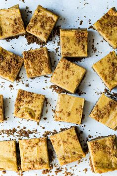 Pumpkin cheesecake cookie butter bars with a crunchy cookie butter base. Get the recipe here at Foodness Gracious