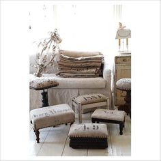 Burlap and linen covered foot stools- love the lettering- very french!