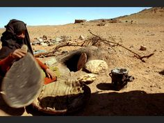 Woman baking bread near Merzouga, Morocco