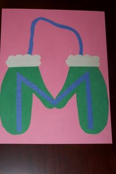 Mitten  template for January calendar.  Use Mitten Song as poem.  Use tracing template for kids w/ scrapbook paper?  Cuffs separate color/paper. Yarn.