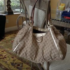 Beige and gold Gucci bag- REDUCED! Authentic beige with gold hardware Gucci bag. Can be used as shoulder or handbag. Used but still good condition. Great size, holds a lot! Gucci Bags