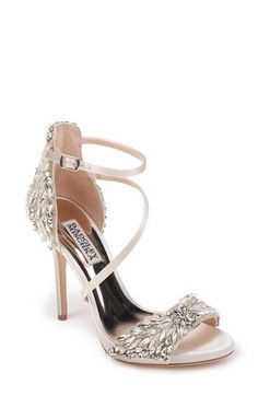 Sparkling crystals encased in lustrous satin define a glamorous strappy sandal lofted by a stiletto heel.