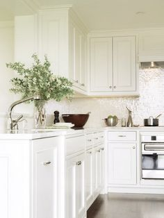 Back Bay Pied-A-Terre - traditional - kitchen - boston - SLC Interiors mother of pearl backsplash tiles Kitchen Backsplash Designs, White Glass Tile, Kitchen Interior, Kitchen Remodel, Kitchen Decor, Kitchen Dining Room, Home Kitchens, Mother Of Pearl Backsplash, Kitchen Design