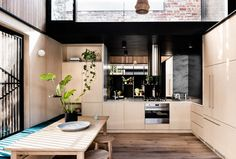 Light Corridor House is a semi-detached worker's cottage in Cremorne, Melbourne, recently renovated by Figr Architecture & Design. Open Plan Kitchen, Kitchen Dining, Kitchen Decor, Kitchen Ideas, Kitchen Oven, Kitchen Benches, Kitchen Shelves, Dining Table, Architecture Awards