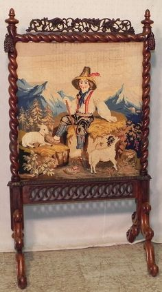 Victorian walnut carved fire screen with needlepoint detail