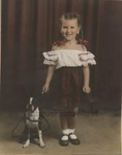 Cute smiling girl posing with Boston Terrier dog antique hand tinted photo