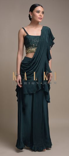 Buy Online from the link below. We ship worldwide (Free Shipping over US$100)  Click Anywhere to Tag Teal Green Ready Pleated Saree In Crepe With A Pre Stitched Ruffle Pallu Online - Kalki Fashion Teal green ready pleated saree in crepe with a pre stitched ruffle pallu.Paired with a matching sleeveless blouse embellished with sequins work in gradient pattern.Designed with strap sleeves and tube neckline.