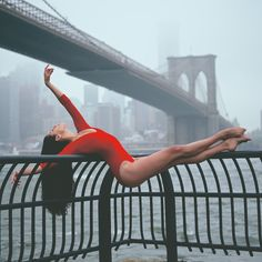 A simple and graceful ballet pose for a dance photoshoot.