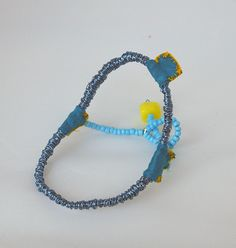 Colored wire, glass beads, silk fabric