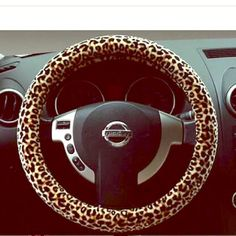 Cheetah print steering wheel cover NWOT! Mint condition, super fun print, and made out of elastic and can fit any wheel  Other