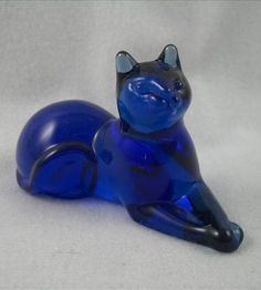 cobalt blue cat figurine is part of the Franklin Mint Curio Cabinet Cats Collection