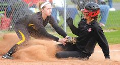 HARDIN NORTHERN third baseman Kamryn Dye slaps a tag on Arlington's Britnee Johnson to get an out in Monday's Blanchard Valley Conference ga...