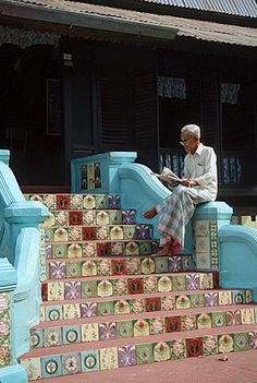 reading on stairs, Melaka, Malaysia / Malacca