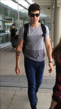 Awwww some took a pic of Shawn after he got his tattoo done