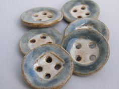 Made with brown stoneware clay, these buttons are cut, carved and stamped by hand. After one firing in an electric kiln, they are then hand