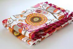 Sew Much Ado: Ric Rac Receiving Blanket tutorial.  http://www.sew-much-ado.com/2009/05/ric-rac-receiving-blanket-tutorial.html