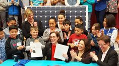 Oregon Gov. Kate Brown, surrounded by those who will benefit the most, signs the Clean Energy and Coal Transition Plan into law. Photo credit: RenewOR