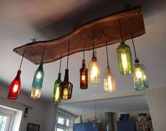 The Gran Marnier Recycled Liqueur Bottle Square Chandelier With Metal Canopy and Vintage Style Edison Bulbs - Modern Rustic Decor Lustre en bouteille Decor, Modern Rustic Decor, Modern Farmhouse Lighting, Diy Home Decor, Diy Chandelier, Farmhouse Lighting, Bottle Chandelier, Wine Bottle Chandelier, Light Fixtures