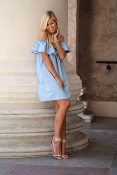 Danish Bloggers to Follow For Copenhagen Fashion Week - Natulia is your girl if you like more feminine and ladylike silo's. Here she's wearing a chambray off the shoulder dress paired with nude heeled sandals