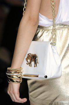.purse with elephant emblem.          t