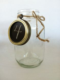reuse snap lids on storage/pantry jars by painting them with chalkboard paint and glueing lid to rim.