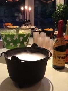 Witch's brew - 2 L white cranberry juice, 2 L ginger ale, neon green food-colouring, lime sherbert