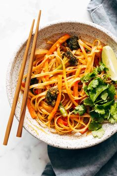 Red Curry Noodles! Lots of fresh veggies, seared tofu, slurpable noodles, and a saucy coconut red curry sauce. Stovetop to table in 30 minutes flat! #noodles #curry #vegetarian #tofu | pinchofyum.com
