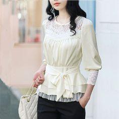 Feminine blouse that elongates the torso, unlike a tucked in blouse.
