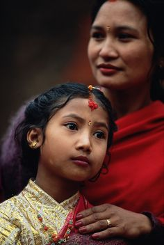 Newar mother and daughter at rite of passage in Patan, Nepal Anders Ryman Newar woman with her daughter at the daughter's Ihi ceremony, a mock marriage to the Hindu god Vishnu, Patan, the Kathmandu...
