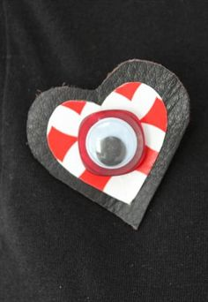 Pretty Disturbia Small Leather Brooch with Playing Card and Eye Detail. Available for £4.00.