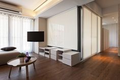 Warm brown flooring & cool white walls: a very stylish combination in this interior in Taiwan. The floor is a Quick-Step Largo laminate 'Cambridge oak dark' (LPU1664) - www.quick-step.com