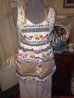 A personal favorite from my Etsy shop https://www.etsy.com/listing/227342219/little-girl-bird-and-flower-apron