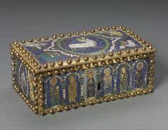 Casket, Northern Germany (?) 1100-1150 | Cleveland Museum of Art.  The casket's iconographic program features the 12 apostles, placed under arcades (on the long sides), the Crucifixion and Christ in Majesty (on the short sides), and the Lamb of God surrounded by the symbols of the four Evangelists (on the lid).