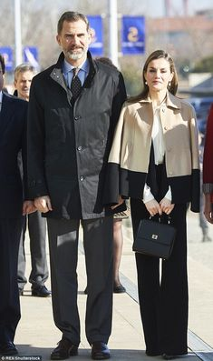 Smiling in the sunshine at an agricultural fair on the Portuguese border, Queen Letizia an...