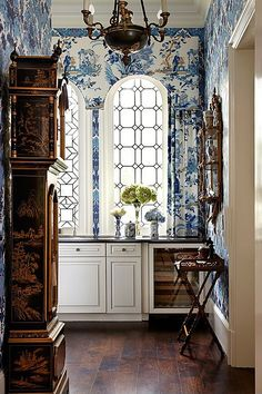 traditional with a large print pattern, chinoiserie clock and leaded glass windows