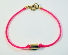 Neon pink charm bracelet - gold plated vintage tube bead and neon pink nylon cord